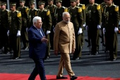 Palestinian President Mahmoud Abbas reviews the honour guard with India's Prime Minister Narendra Modi in Ramallah, in the occupied West Bank February 10, 2018. REUTERS/Mohamad Torokman