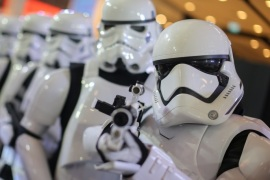 People dressed as characters from Star Wars take part in an event held for the release of the film