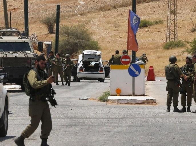 جثة الجندي كانت قرب نقطة تفتيش عسكرية تقع بين الضفة الغربية المحتلة والقدس الشرقية (رويترز-أرشيف)