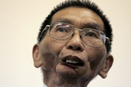 Tsai Lin-jang, who lost his jaw due to oral cancer, listens to a question during an interview with Reuters in Taoyuan July 3, 2007. Tsai, 60, had eaten betel nuts for 25 years, till he developed the cancer. He has since quit eating them after losing his jaw. For centuries, hundreds of millions of people across Asia, from Pakistan to Palau, have chewed the spicy date-like fruit of the betel palm for a quick buzz. Then four years ago, a World Health Organisation study found that chewing betel nuts can cause oral cancer and that the rate of these malignant mouth tumours was highest in Asia where the betel nut is a widely used stimulant. To match feature TAIWAN-BETELNUT/  REUTERS/Pichi Chuang (TAIWAN)