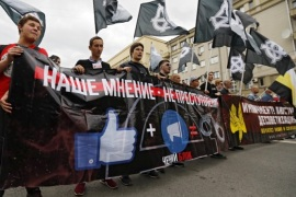 epa06164594 Russian activists carry a banner reading 'The censorship' during a rally for free internet in Moscow, Russia, 26 August 2017. In 2016, Russia passed the Yarovaya law, a package of legal amendments intended to combat terrorism that limited internet privacy and tightened government control over the internet. EPA-EFE/SERGEI ILNITSKY