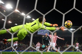 STOKE ON TRENT, ENGLAND – MARCH 12:  David Silva of Manchester City (C) scores their first goal past Jack Butland of Stoke City (1) during the Premier League match between Stoke City and Manchester City at Bet365 Stadium on March 12, 2018 in Stoke on Trent, England.  (Photo by Gareth Copley/Getty Images)