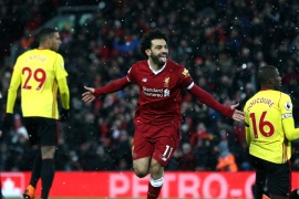 LIVERPOOL, ENGLAND – MARCH 17:  Mohamed Salah of Liverpool celebrates scoring his side's fourth goal during the Premier League match between Liverpool and Watford at Anfield on March 17, 2018 in Liverpool, England.  (Photo by Jan Kruger/Getty Images)