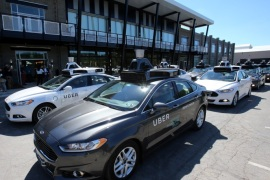 A fleet of Uber's Ford Fusion self driving cars are shown during a demonstration of self-driving automotive technology in Pittsburgh, Pennsylvania, U.S. September 13, 2016.  REUTERS/Aaron Josefczyk