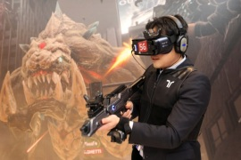 A man plays Special Force VR Universal War, the world's first multi-player VR Game with 5G technology, inside Korean Telecom (KT) booth at the Mobile World Congress in Barcelona, Spain, February 28, 2018. REUTERS/Sergio Perez