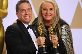 "90th Academy Awards – Oscars Backstage – Hollywood, California, U.S., 04/03/2018 – Lee Unkrich (L) and Darla K. Anderson hold their Oscars for Best Animated Feature Film ""Coco"". REUTERS/Mike Blake"