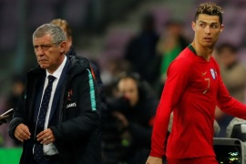 Soccer Football – International Friendly – Portugal vs Netherlands – Stade de Geneve, Geneva, Switzerland – March 26, 2018   Portugal's Cristiano Ronaldo walks off after being substituted as Portugal coach Fernando Santos looks on    REUTERS/Denis Balibouse