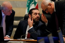 Finance Minister Ali Hassan Khalil gestures as he talks with Lebanon's Prime Minister Saad al-Hariri during a cabinet meeting at the governmental palace in Beirut, Lebanon March 12, 2018. REUTERS/Mohamed Azakir
