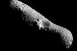 385446 03: FILE PHOTO: A mosaic image of asteroid Eros at it's north pole, taken by the robotic NEAR Shoemaker space probe February 14, 2000 immediately after the spacecraft's insertion into orbit. After a year of circling and taking pictures, NEAR will touch down on asteroid Eros February 12, 2001, to capture surface details, which will be the first time any craft has tried to land on a tumbling space rock. (Photo Courtesy of NASA/Newsmakers)