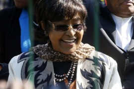 Winnie Madikizela-Mandela greets wellwishers gathered to wish to former President Nelson Mandela happy birthday outside the hospital where he is being treated in Pretoria, July 18, 2013. The ailing Mandela turns 95 today.  REUTERS/Mike Hutchings (SOUTH AFRICA – Tags: POLITICS HEALTH)