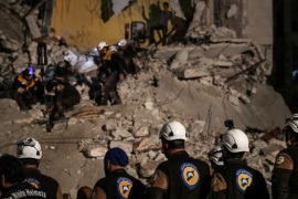 Volunteers of White Helmets search for survivors after an explosion in the city of Idlib, Syria, 09 April 2018