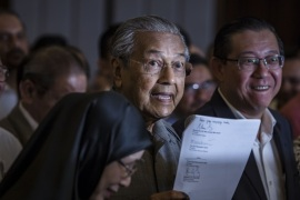 KUALA LUMPUR, MALAYSIA – MAY 10:  Mahathir Mohamad, chairman of 'Pakatan Harapan' (The Alliance of Hope), holds document during press conference following the 14th general election on May 10, 2018 in Kuala Lumpur, Malaysia.  Malaysia's opposition leader Mahathir Mohamad claimed victory over Prime Minister Najib Razak's ruling coalition Barisan National and set to become the world's oldest elected leader after Wednesday's general election where millions of Malaysia
