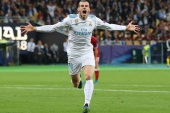Soccer Football – Champions League Final – Real Madrid v Liverpool – NSC Olympic Stadium, Kiev, Ukraine – May 26, 2018   Real Madrid's Gareth Bale celebrates scoring their second goal    REUTERS/Hannah McKay     TPX IMAGES OF THE DAY