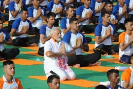 Indian Prime Minister Narendra Modi performs yoga on International Yoga Day in Dehradun in the northern Himalayan state of Uttarakhand, India June 21, 2018. REUTERS/Stringer