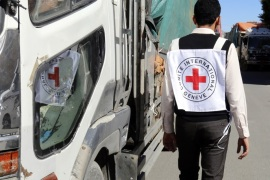epa06791768 (FILE) – A member of staff from the International Committee of the Red Cross passes a truck carrying ICRC-provided emergency medical aid, in Sana'a, Yemen, 13 December 2017 (issued 07 June 2018). According to reports, the International Committee of the Red Cross (ICRC) has pulled 71 staff members out of Yemen amid rising insecurity in the war-torn Arab country. EPA-EFE/YAHYA ARHAB