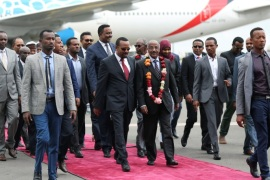 Ethiopia's Prime Minister Abiy Ahmed welcomes Eritrean Foreign Minister Osman Saleh and his delegation at the Bole International Airport in Addis Ababa, Ethiopia June 26, 2018. REUTERS/Tiksa Negeri