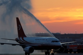 An airplane carrying Turkey's President Tayyip Erdogan receives water salute after landing to the Istanbul's third international airport which is still under construction during a ceremony marking the first landing, Turkey, June 21, 2018. REUTERS/Umit Bektas