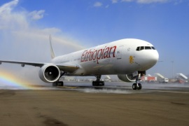 Ethiopian Airlines' newly acquired Boeing 777-300ER aircraft, with a seating capacity of 400 passengers, arrives at the Bole International Airport in Capital Addis Ababa November 8, 2013. REUTERS/Tiksa Negeri (ETHIOPIA – Tags: TRANSPORT BUSINESS)