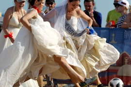 Women wearing wedding dresses take part in the so-called