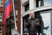 LONDON, ENGLAND – MAY 19:  Julian Assange speaks to the media from the balcony of the Embassy Of Ecuador on May 19, 2017 in London, England.  Julian Assange, founder of the Wikileaks website that published US Government secrets, has been wanted in Sweden on charges of rape since 2012.  He sought asylum in the Ecuadorian Embassy in London and today police have said he will still face arrest if he leaves.  (Photo by Jack Taylor/Getty Images)