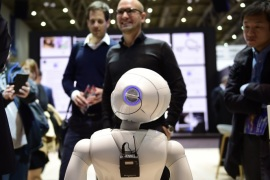 HANOVER, GERMANY – MARCH 20: The robot 'Pepper' speaks with visitors at the IBM stand at the CeBIT 2017 Technology Trade Fair on March 20, 2017 in Hanover, Germany. 'Pepper' has a face detection and is either used to greet Hotel guests during arrival or can be personalized by his owner to help in the household. The 2017 CeBIT will run from March 20-24. (Photo by Alexander Koerner/Getty Images)