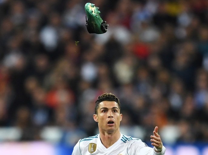 MADRID, SPAIN – APRIL 11:  Cristiano Ronaldo of Real Madrid reacts as his boot flies through the air during the UEFA Champions League Quarter Final Second Leg match between Real Madrid and Juventus at Estadio Santiago Bernabeu on April 11, 2018 in Madrid, Spain.  (Photo by David Ramos/Getty Images)