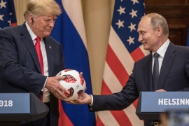 HELSINKI, FINLAND – JULY 16:  Russian President Vladimir Putin hands U.S. President Donald Trump (L) a World Cup football during a joint press conference after their summit on July 16, 2018 in Helsinki, Finland. The two leaders met one-on-one and discussed a range of issues including the 2016 U.S Election collusion.  (Photo by Chris McGrath/Getty Images)