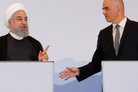 Swiss President Alain Berset and Iranian President Hassan Rouhani gesture after they deliver a statement after a two day visit in Bern, Switzerland, July 3, 2018. REUTERS/Denis Balibouse