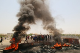 Iraqi protesters burn tires and block the road at the entrance to the city of Basra, Iraq July 12, 2018. REUTERS/Essam al-Sudani