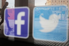 Facebook and Twitter logos are seen on a shop window in Malaga, Spain, June 4, 2018. REUTERS/Jon Nazca