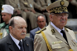 Algeria's President and head of the Armed Forces Abdelaziz Bouteflika (C) ,Army Chief of Staff General Ahmed Gaid Salah (R) and Abdelmalek Guenaizia, Minister Delegate to the Defence ministry attend a graduation ceremony of the 40th class of trainee army officers at a Military Academy in Cherchell 90 km west of Algiers June 27, 2012. REUTERS/Ramzi Boudina (ALGERIA – Tags: POLITICS)