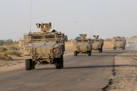 epa04920385 Military vehicles of the Saudi-led coalition forces drive towards the eastern province of Marib, Yemen, 08 September 2015. Troops from an alliance of Gulf states began marching towards the front lines with Houthi rebels in Marib province, east of the capital Sana'a. The troops moved from the Safer base, where three days earlier 60 coalition soldiers were killed in a missile strike claimed by the Houthi-controlled Yemeni Defence Ministry. EPA/STRINGER