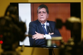 "epa04815992 Former Peruvian president Alan Garcia is seen on a monitor during a hearing in Lima, Peru, on 23 June 2015. Garcia appeared in court to testify as witness in the process of the alleged corruption case known as ""Petroaudios"", during his second term in office (2006-2011), in which is accused Dominican businessman Fortunato Canaan. Garcia admitted that he met twice in 2007 with Canaan, who was a representative of the Norwegian company Discover Petroleum, which is accused of having received oil concessions illegally. EPA/STR"