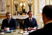French President Emmanuel Macron sits across from Prime Minister Edouard Philippe at the start of a meeting at the Elysee Palace day after clashes between police and yellow vest protesters, in Paris, France, December 2, 2018.  REUTERS/Stephane Mahe/Pool
