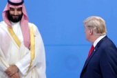 BUENOS AIRES, ARGENTINA – NOVEMBER 30: U.S. President Donald Trump looks over at Crown Prince of Saudi Arabia Mohammad bin Salman al-Saud as they line up for the family photo during the opening day of Argentina G20 Leaders' Summit 2018 at Costa Salguero on November 30, 2018 in Buenos Aires, Argentina. (Photo by Daniel Jayo/Getty Images)