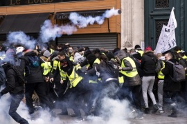 epa07244724 Clashes erupt between the French riot police and demonstrators during a 'Yellow Vests' protest near La Madeleine in Paris, France, 22 December 2018. The so-called 'gilets jaunes' (yellow vests) is a protest movement, which reportedly has no political affiliation, that continues protests across the nation over high fuel prices. EPA-EFE/ETIENNE LAURENT