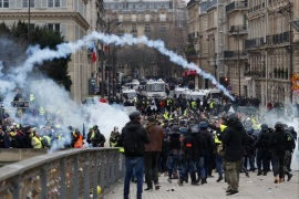 epa07263573 French riot police clashes with protesters as they try to cross the Seine river during a 'Yellow Vests' protest in Paris, France, 05 January 2019. The so-called 'gilets jaunes' (yellow vests) is a grassroots protest movement with supporters from a wide span of the political spectrum, that originally started with protest across the nation in late 2018 against high fuel prices. The movement in the meantime also protests the French government's tax reforms, the increasing costs of living and some even call for the resignation of French president Emmanuel Macron. EPA-EFE/IAN LANGSDON