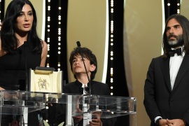 CANNES, FRANCE – MAY 19:  Actor Zain Alrafeea (C) looks on as Director Nadine Labaki receives the Jury Prize award for 'Capharnaum' as her producer and husband Khaled Mouzanar (R) watches her on stage during the Closing Ceremony at the 71st annual Cannes Film Festival at Palais des Festivals on May 19, 2018 in Cannes, France.  (Photo by Pascal Le Segretain/Getty Images)