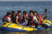 KOS, GREECE – AUGUST 28:  Migrant men arrive in an inflatable dinghy on the beach at sunrise on the island of Kos after crossing a three mile stretch of the Aegean Sea from Turkey on August 28, 2015 in Kos, Greece. Migrants from the Middle East and North Africa continue to flood into Europe at a rate that marks the largest migration since World War II.  (Photo by Dan Kitwood/Getty Images)