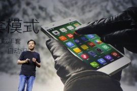 Lei Jun, founder and chief executive officer of China's mobile company Xiaomi Inc, introduces the new features of Xiaomi Phone 4 at its launching ceremony, in Beijing, July 22, 2014. When popular Chinese handset maker Xiaomi Inc admitted that its devices were sending users' personal information back to a server in China, it prompted howls of protest and an investigation by Taiwan's government. The affair has also drawn attention to just how little we know about what happens between our smartphone and the outside world. Picture taken July 22, 2014. REUTERS/Jason Lee (CHINA – Tags: BUSINESS TELECOMS SCIENCE TECHNOLOGY)