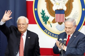 epa06736334 US Ambassador to Israel David Friedman (L) waves as Israeli Prime Minister Minister Benjamin Netanyahu (R) applauds during the opening ceremony at the US consulate that will act as the new US embassy in the Jewish neighborhood of Arnona, in Jerusalem, Israel, 14 May 2018. The US Embassy in Jerusalem is inaugurated on 14 May following its controversial move from Tel Aviv to the existing US consulate building in Jerusalem. US President Trump in December 2017 recognized Jerusalem as Israel's capital. The decision, condemned by Palestinians who claim East Jerusalem as the capital of a future state, prompted worldwide protests and was met with widespread international criticism. EPA-EFE/ABIR SULTAN