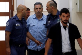 Gonen Segev, a former Israeli cabinet minister indicted on suspicion of spying for Iran, is escorted by prison guards as he arrives to court in Jerusalem, July 5, 2018  REUTERS/Ronen Zvulun