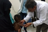 Famine in Yemen- – MARIB, YEMEN – DECEMBER 13 : A doctor checks a child, who is suffering from severe malnutrition, in Marib, Yemen on December 13, 2018. Many children are affected by the famine as a consequence of ongoing war and conflicts in Yemen. Refugees try to make their way to a hospital in Marib in the central Yemen for their children to receive treatment.