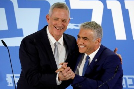 Benny Gantz, head of Resilience party and Yair Lapid, head of Yesh Atid, hold a news conference to announce the formation of their joint party, following an alliance between their parties, in Tel Aviv, Israel February 21, 2019. REUTERS/Amir Cohen