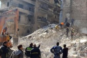epa07337713 A handout photo released by Syria's Arab News Agency SANA shows a collapsed building in the northern city of Aleppo, Syria, 02 February 2019. According to Sana, 11 people were killed when a five-story building collapsed in Saladin neighborhood in Aleppo. Another man was rescued from underneath the rubble. Sana added that the building located in a damaged area that was repeatedly hit by terrorist attacks, raising the likelihood that the building might be cra