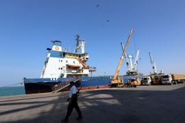 A coast guard walks past a ship docked at the Red Sea port of Hodeidah, Yemen January 5, 2019. Picture taken January 5, 2019. REUTERS/Abduljabbar Zeyad