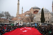 Reactions to twin terror attacks on New Zealand mosques in Turkey- – ISTANBUL, TURKEY – MARCH 16: People stage a demonstration condemning twin terror attacks targeting mosques in Christchurch, New Zealand, on March 16, 2019 in front of Hagia Sophia Museum as they unfurl a Turkish flag in Istanbul, Turkey. At least 49 people were reportedly killed in the terror attacks.