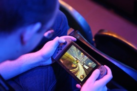 A fan plays Rocket League on a Nintendo Switch during day one of the Rocket League Championship Series Finals in London, Britain, June 8, 2018. REUTERS/Tom Jacobs