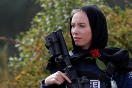 A policewoman is seen as people attend the burial ceremony of a victim of the mosque attacks, at the Memorial Park Cemetery in Christchurch, New Zealand March 21, 2019. REUTERS/Jorge Silva