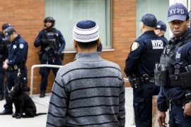 epa07440469 New York City police officers, including officers from the department's Counterterrorism Unit, provide security at the Islamic Cultural Center of New York as people arrive for Friday prayers in New York, New York, USA, 15 March 2019. Security in New York, and at sites around the world, was heightened following what was described as terrorist attacks at two mosques in New Zealand where 49 people were killed by a gunman and 20 more injured and in critical con